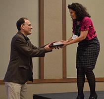 Photo of Tim Harrison receiving award